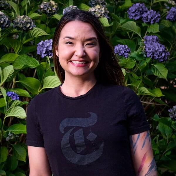 DigiPen graduate Romina Barrett wearing a New York Times logo t-shirt.