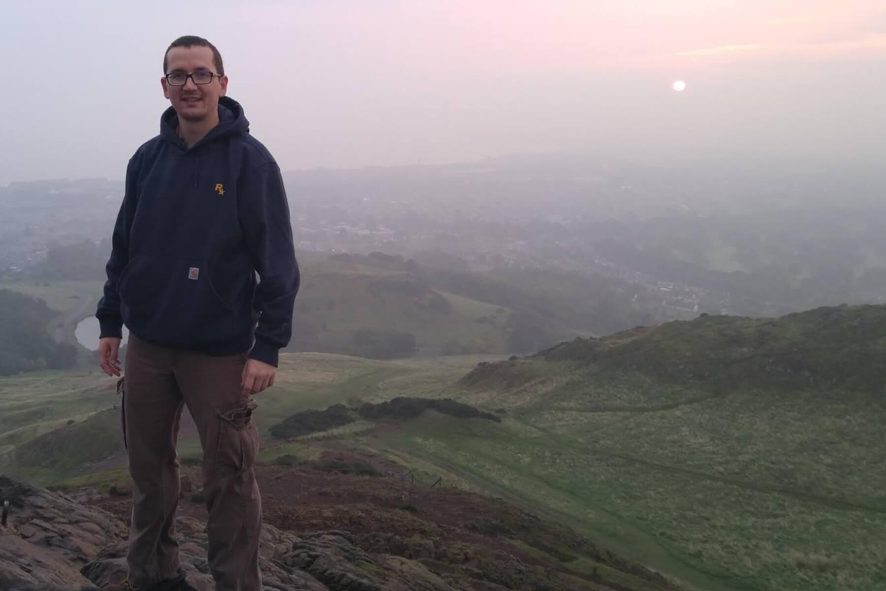 Andy Kibler poses at Arthur's Seat in Scotland