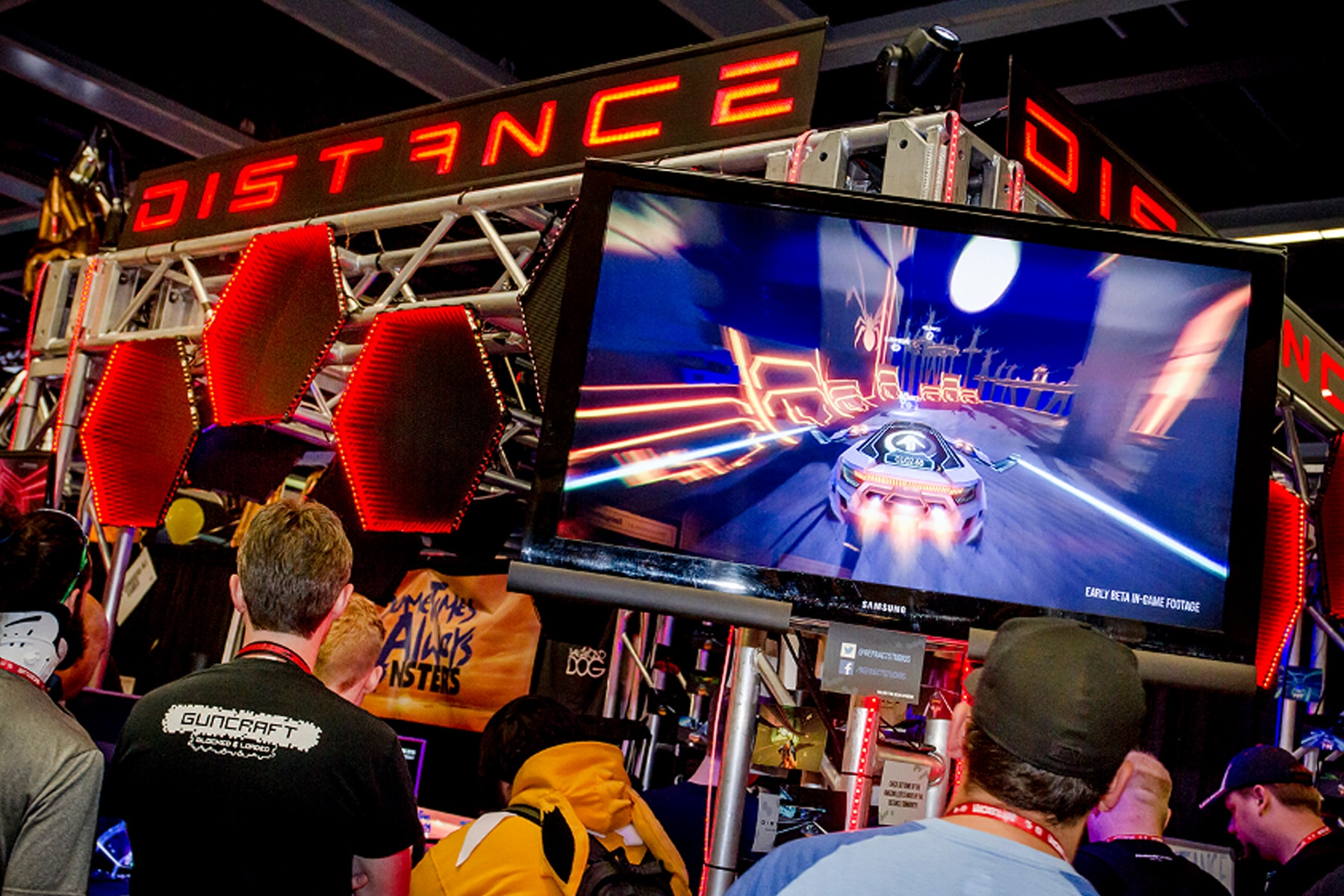 PAX attendees playing Distance at the Refract Studios booth