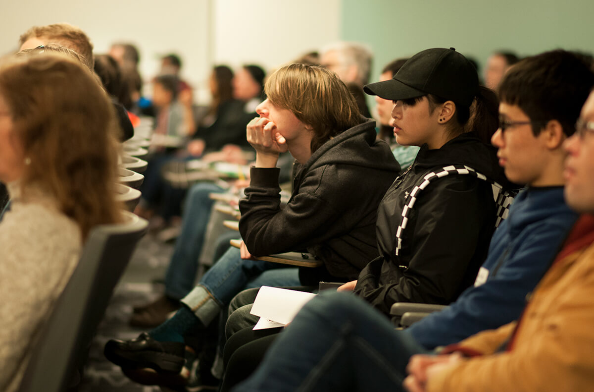 The audience at the DigiPen-hosted Bungie Career Talk listens intently to alumnus Peter Kugler