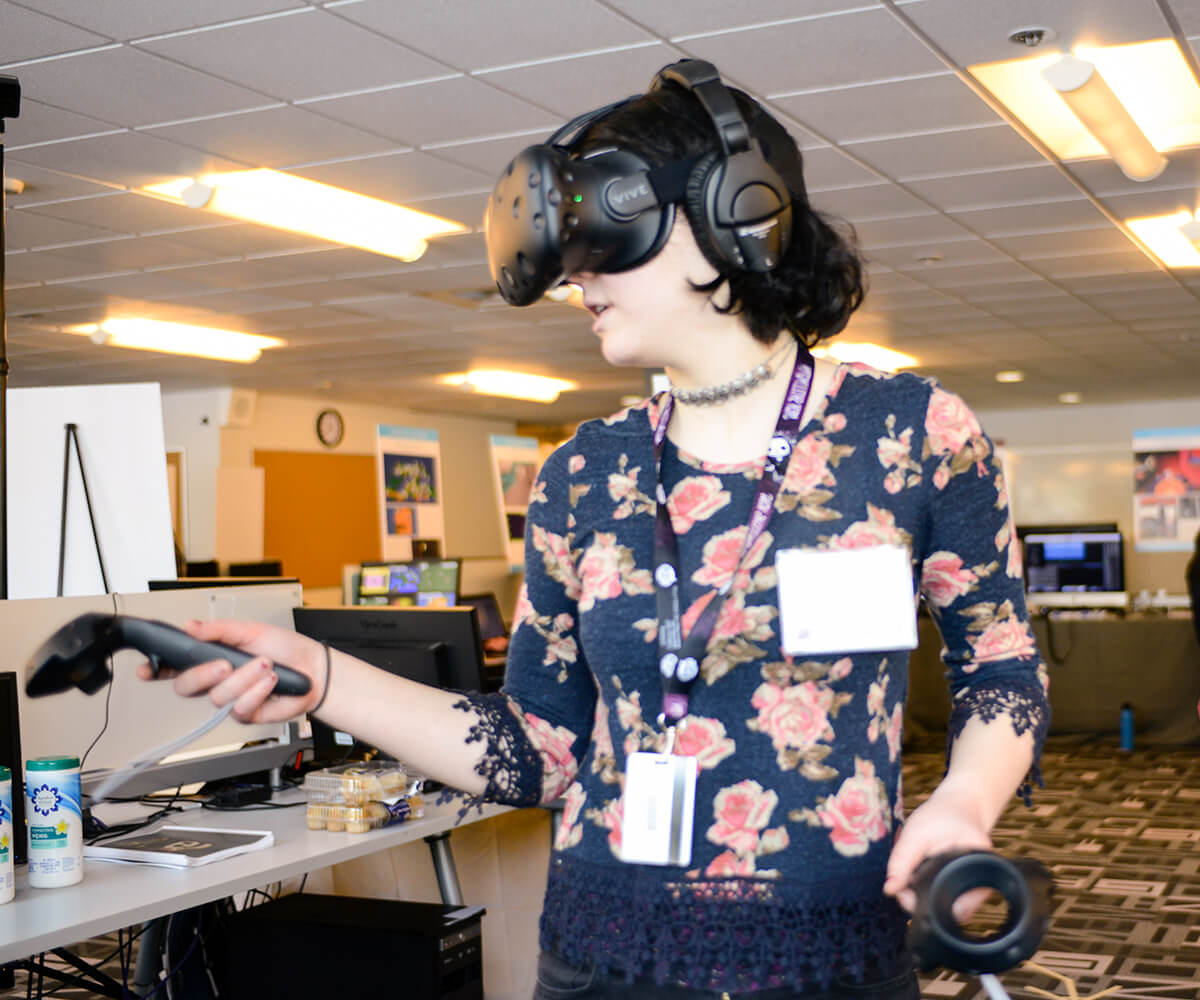 A DigiPen student demonstrating her virtual reality game