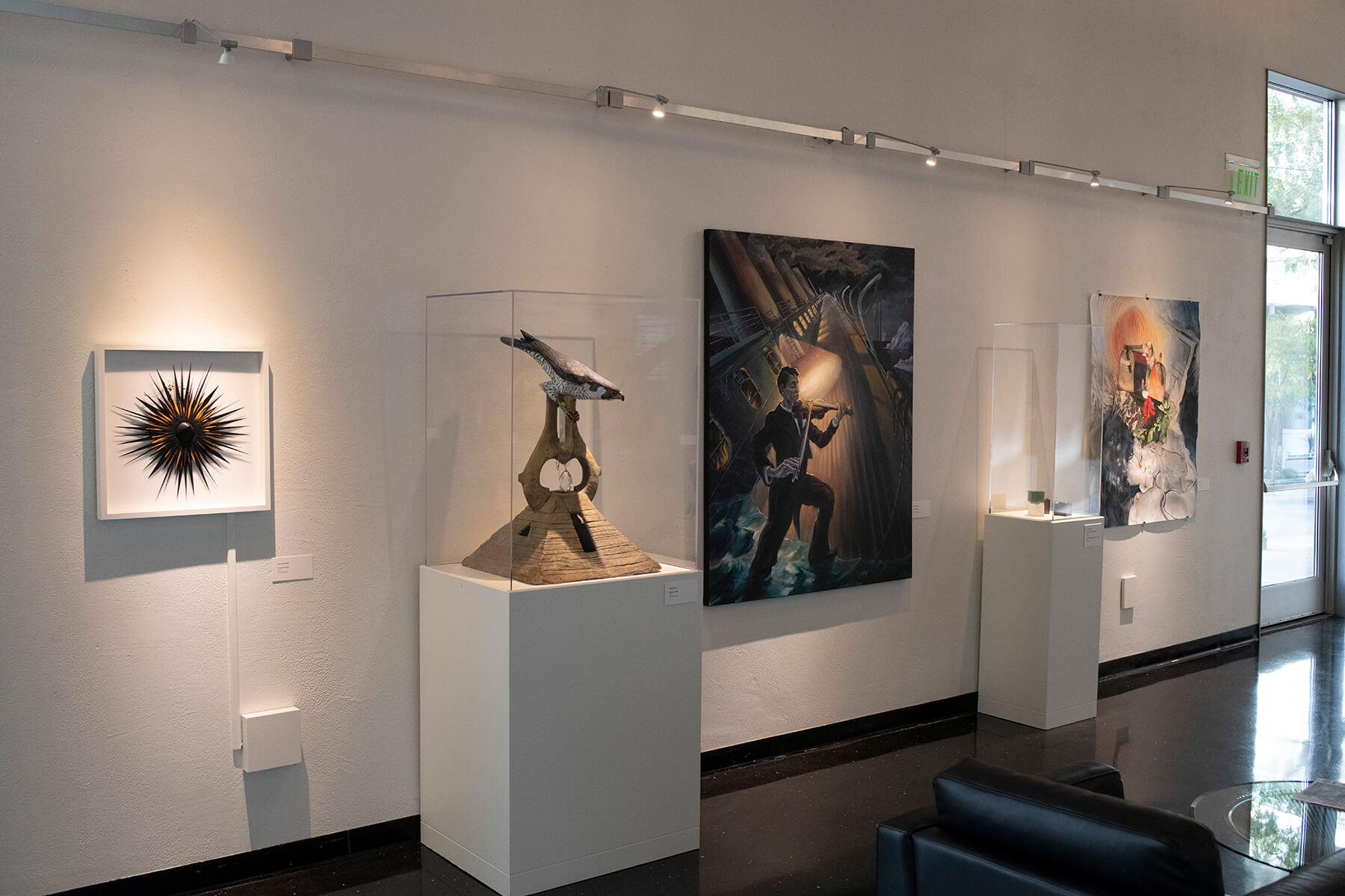 Various abstract and representational faculty art pieces on display at the Bellevue Art Museum.
