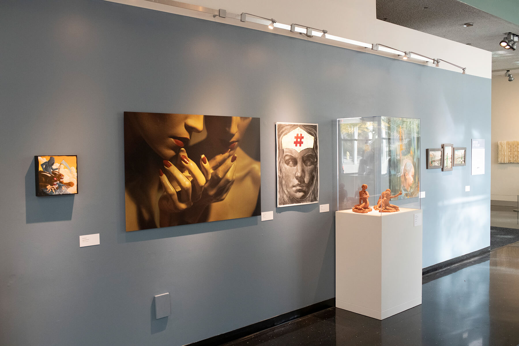 Various faculty art pieces — including photography, drawing, sculpture, and more — on display at the Bellevue Art Museum.