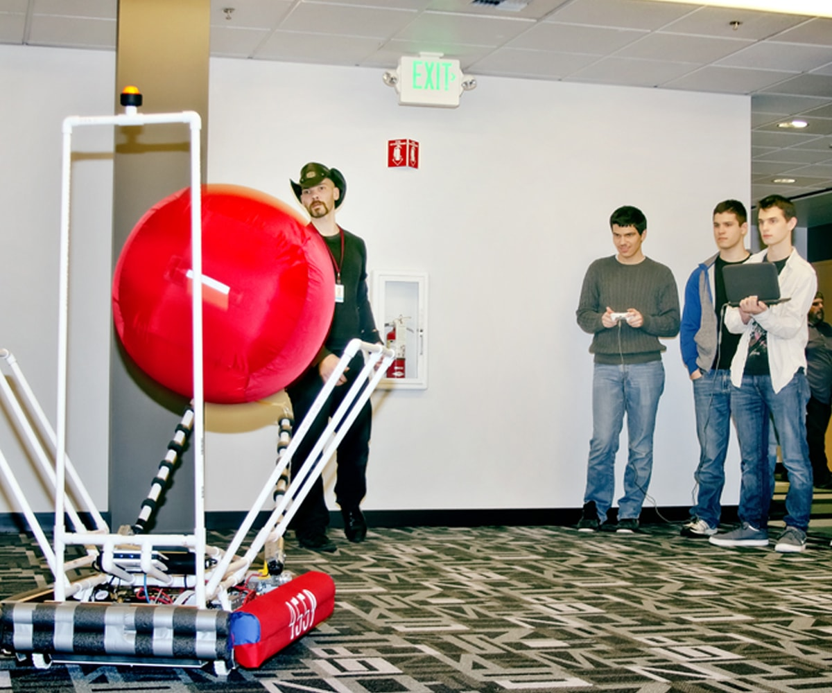 First draft team evaluates new flexible chassis framework by throwing ball into robot arms