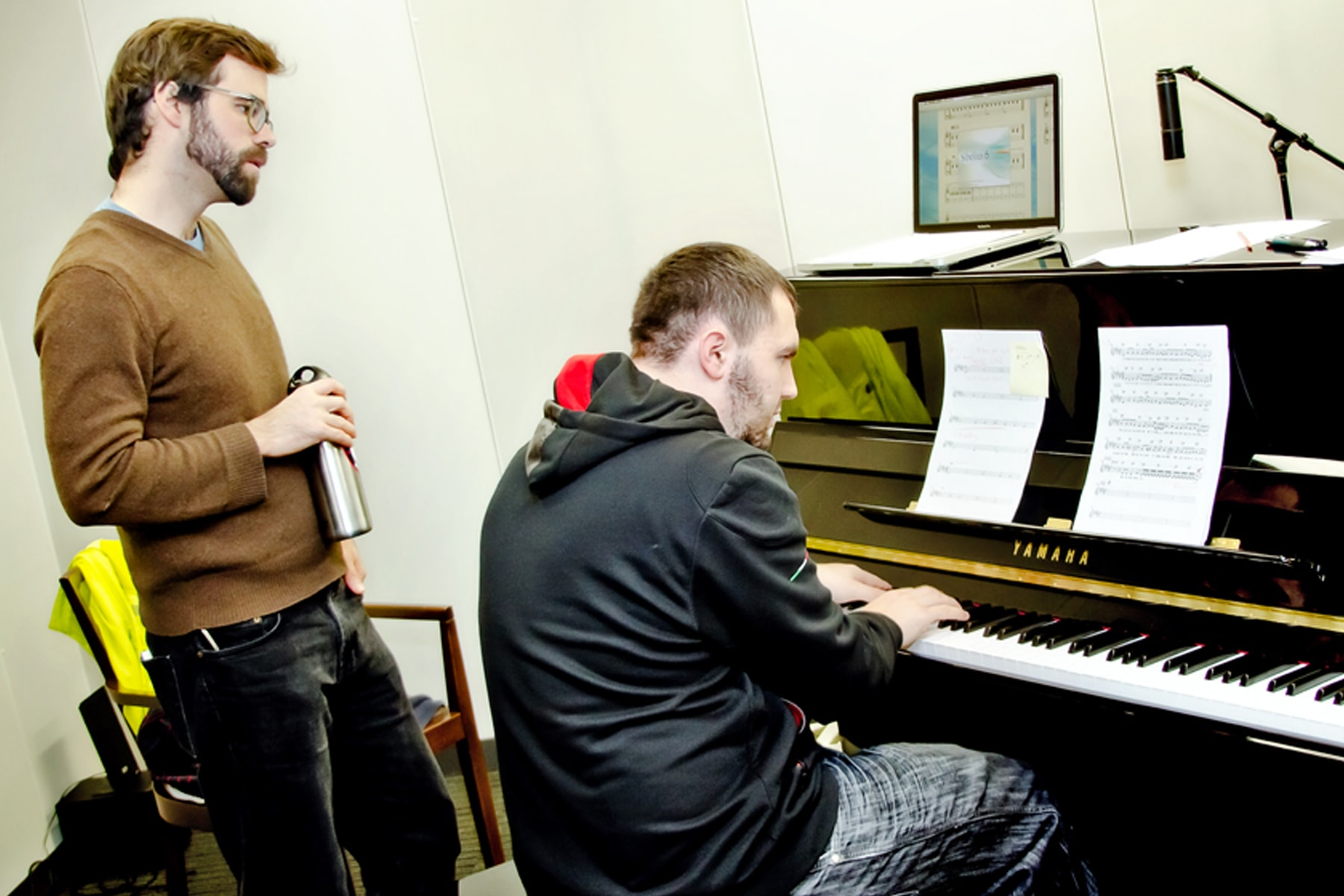 DigiPen students playing the piano in the new sound lab recording studio