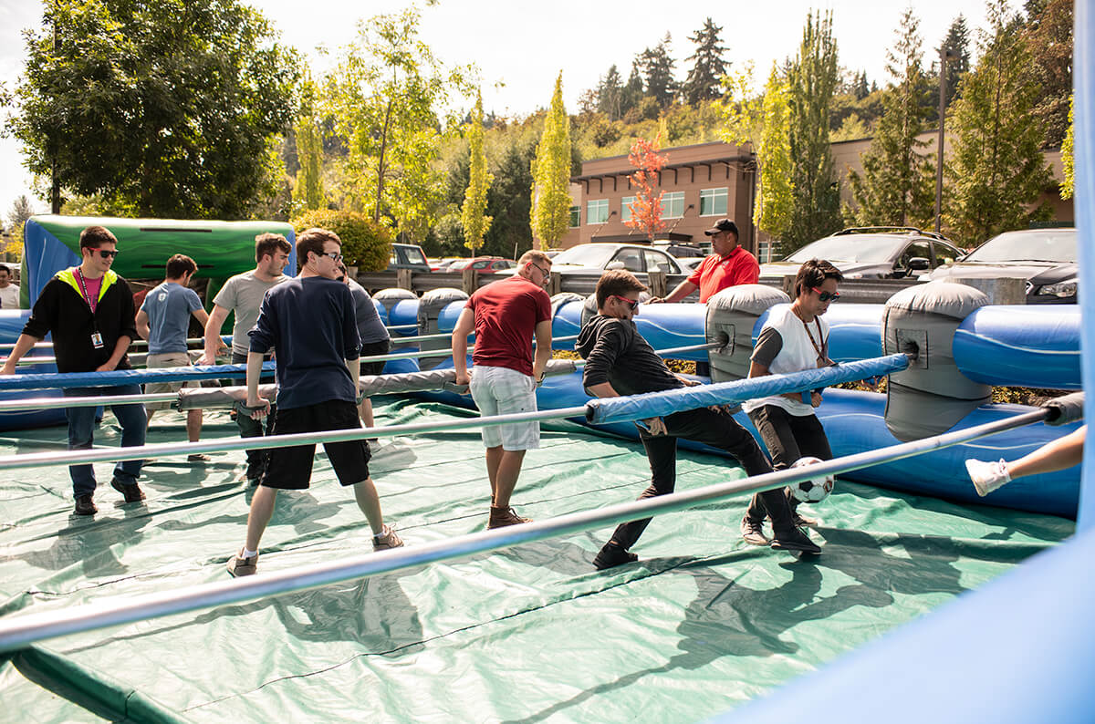 DigiPen students play human foosball on an inflatable court