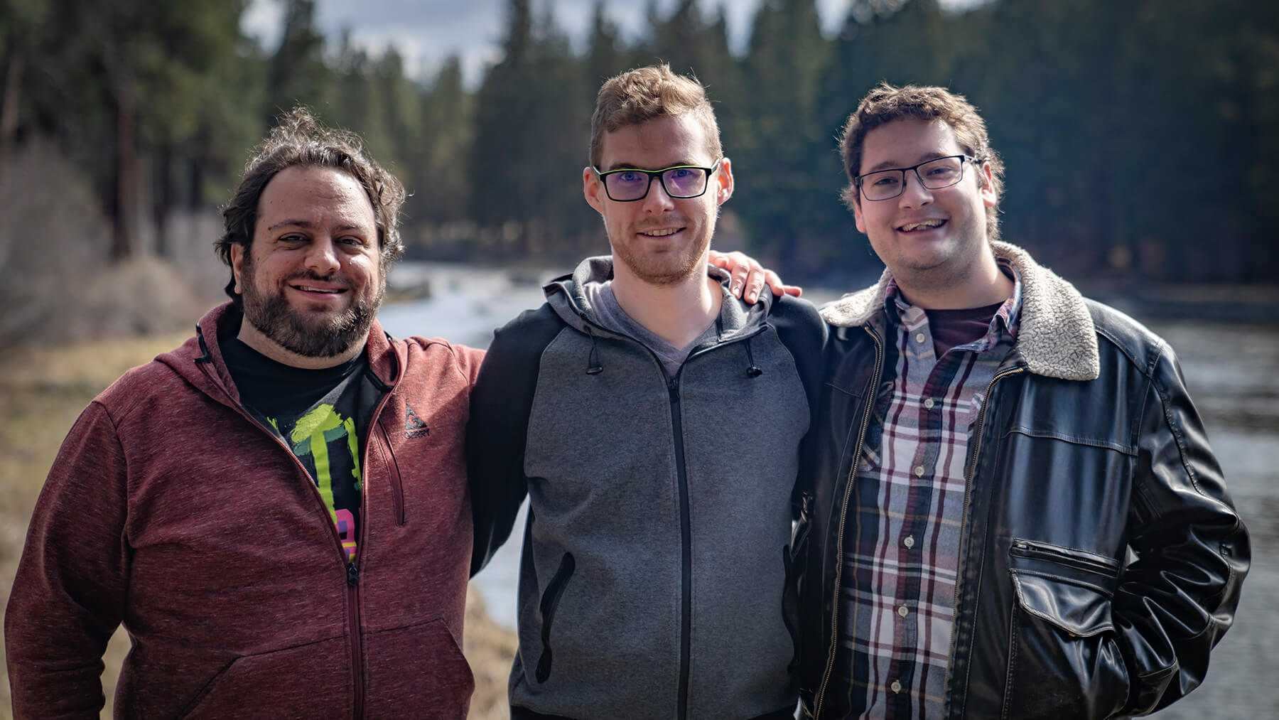 DigiPen alumni Geoffrey Hammon, Sawyer Paradise, and Jacob Fieth pose in the Bend, Oregon wilderness.