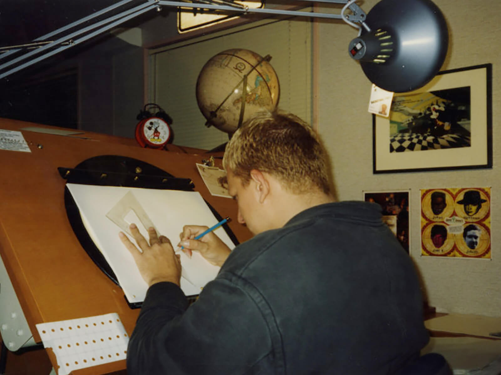 DigiPen BFA director Jazno Francoeur drawing at his desk at Disney Feature Animation Florida
