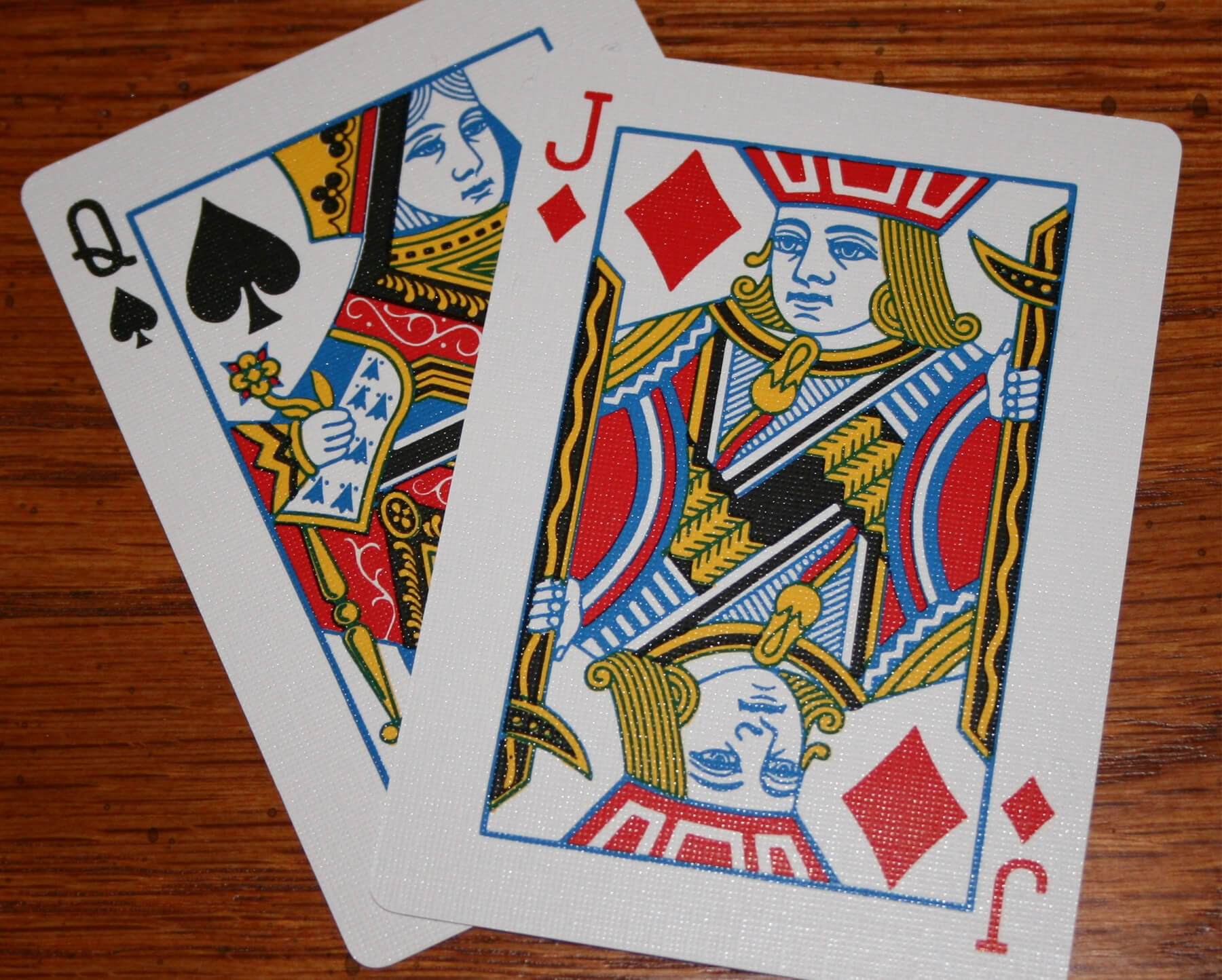 A queen of aces and jack of diamonds card.