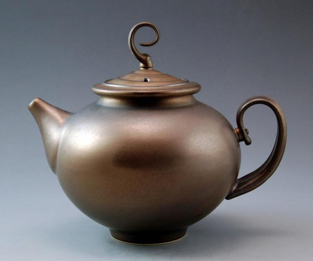 Bronze-colored teapot sculpted by Ken Turner