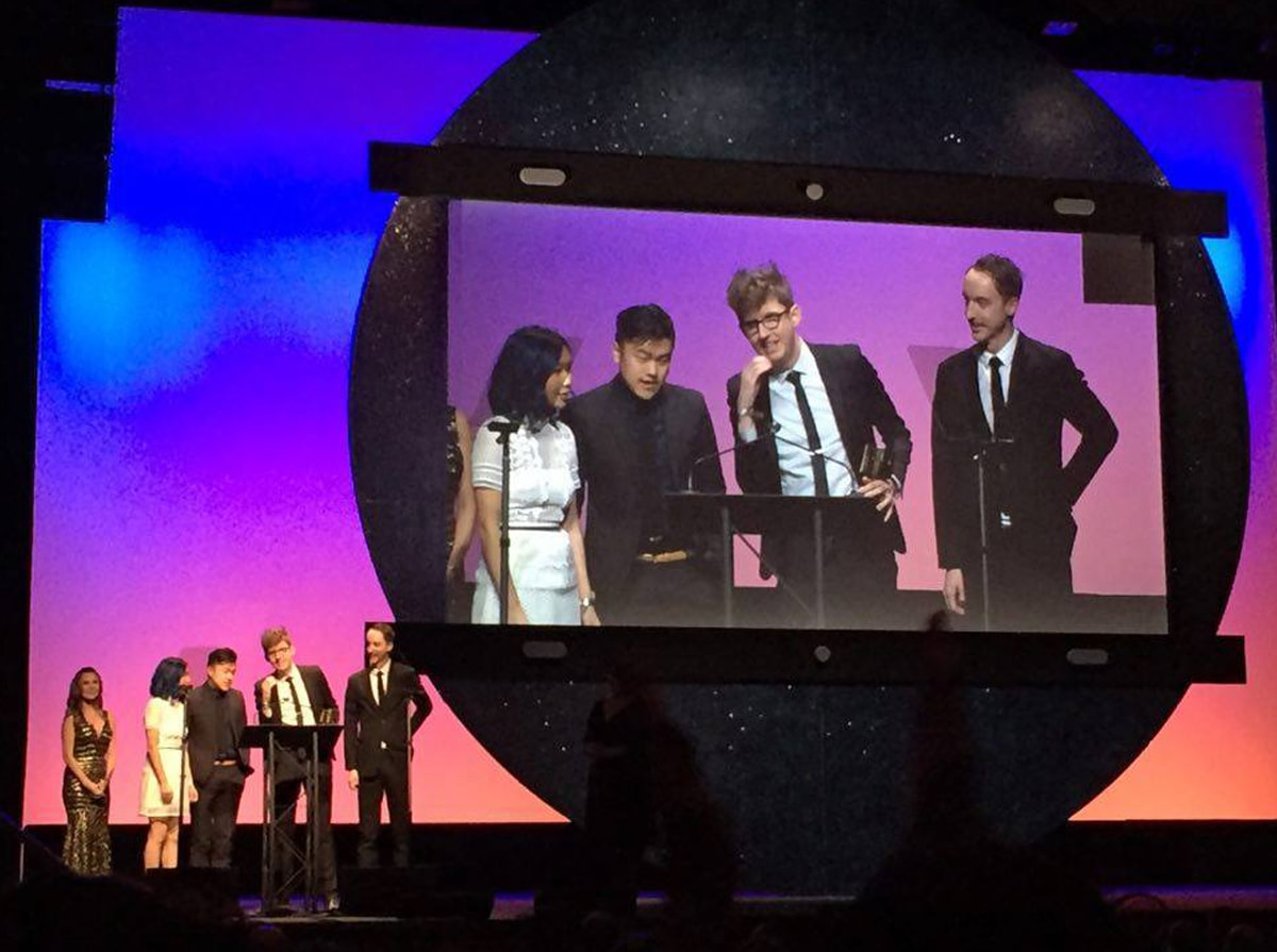 DigiPen alumni Kevin Dart and Chris Turnham on stage accepting an Annie award