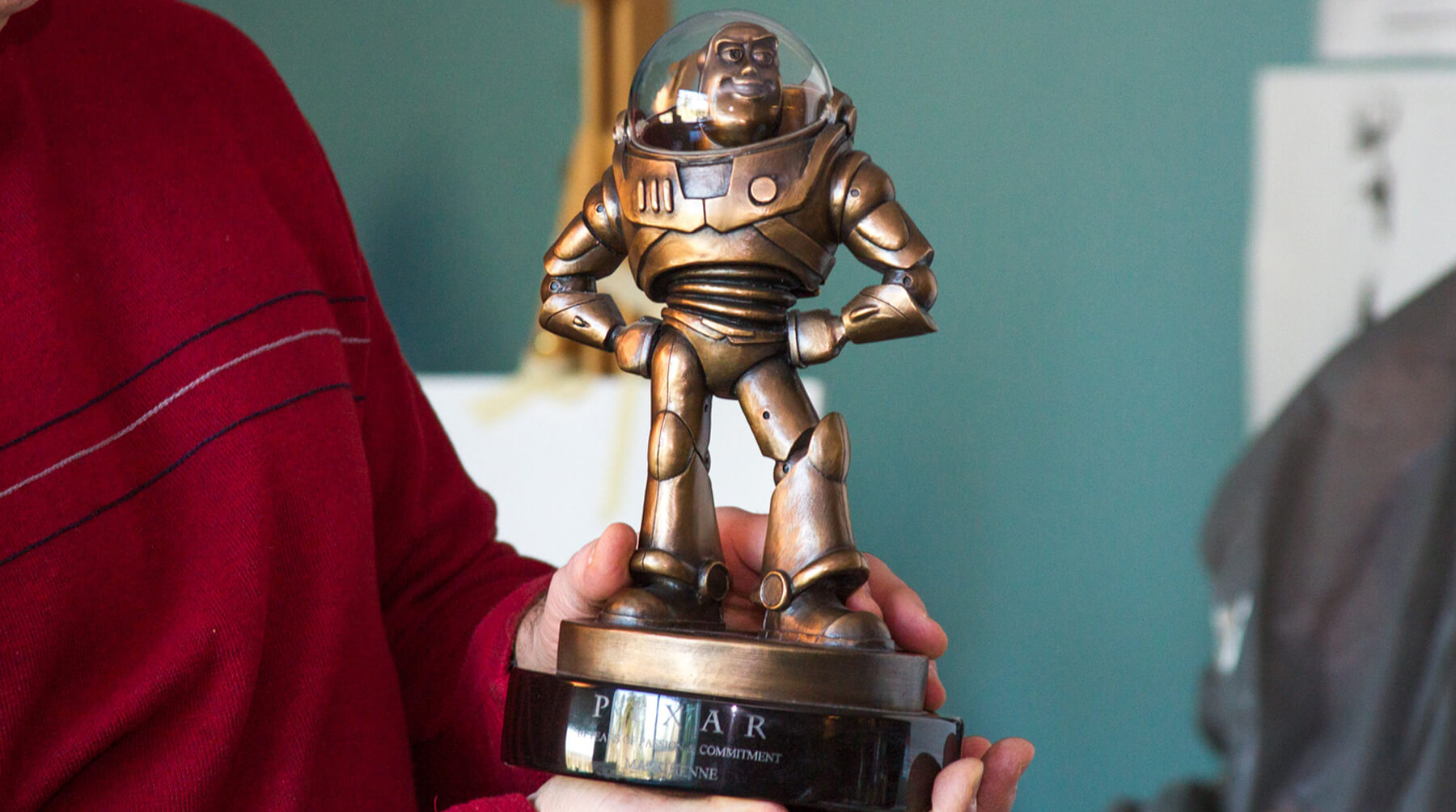 DigiPen Digital Arts lecturer Mark Henne shows his Pixar Award for Passionate Commitment, a bronze Buzz Lightyear trophy