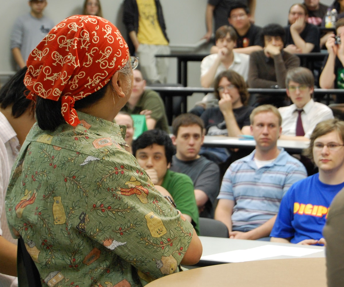 DigiPen students listen intently to Nobuo Uematsue, who's wearing a bicycle-printed head scarf