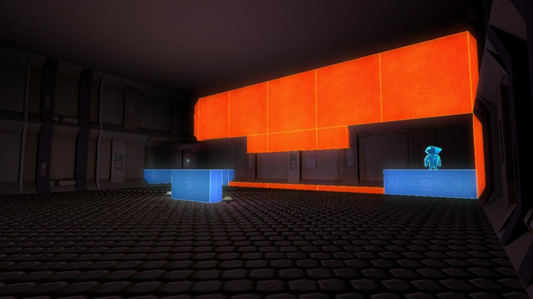 Screenshot of the main character standing on a blue box in a gray room