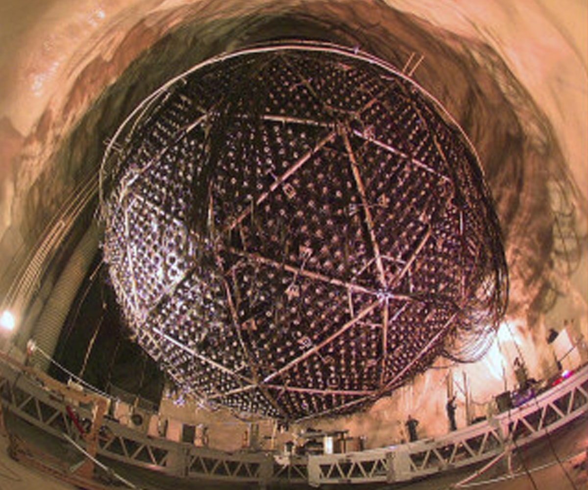 The SNO Detector, which resembles a giant golf ball, is suspended from the cavern ceiling