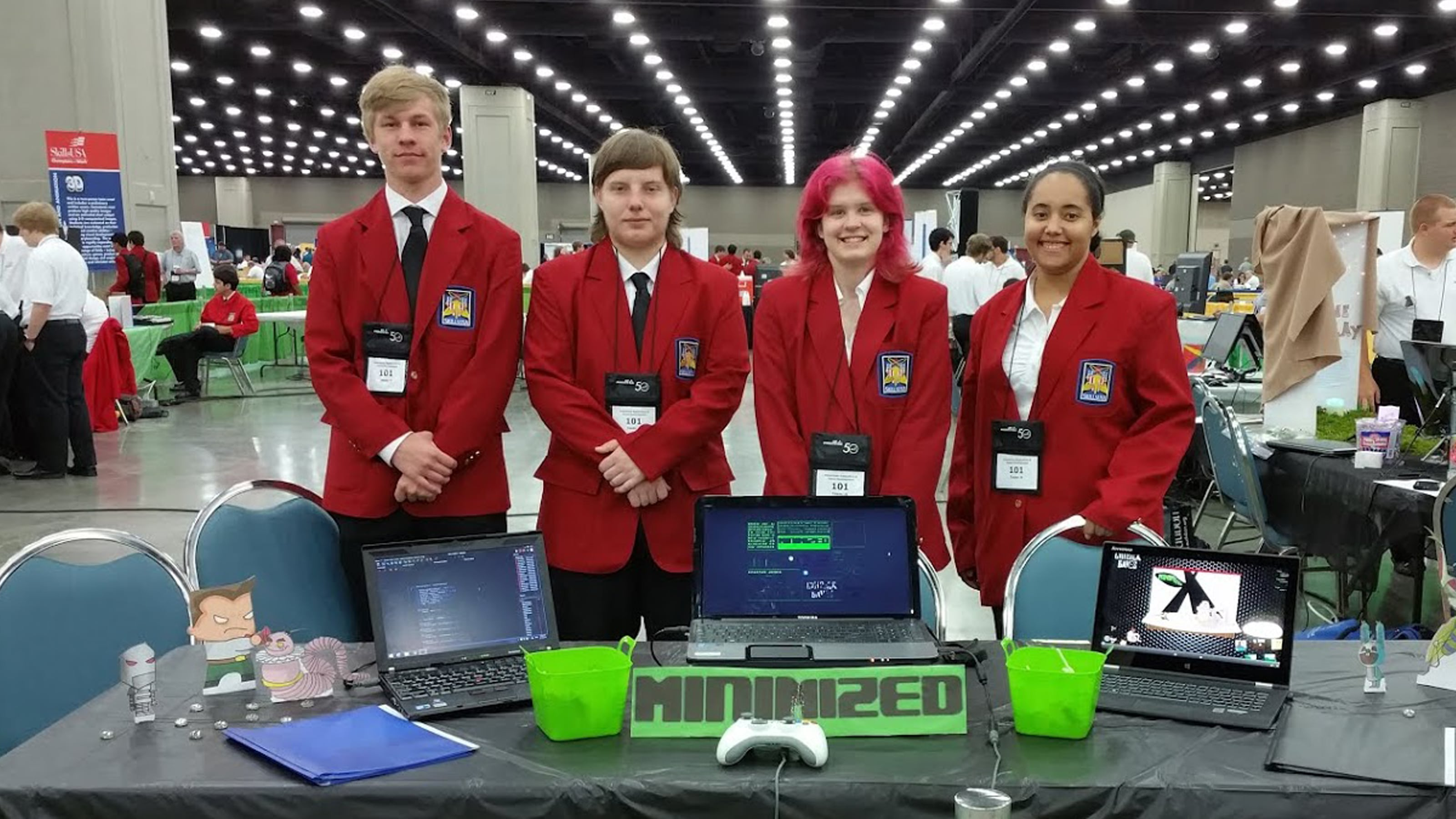 DigiPen WANIC Academy students posing in matching red jackets at their booth at the SkillsUSA competition