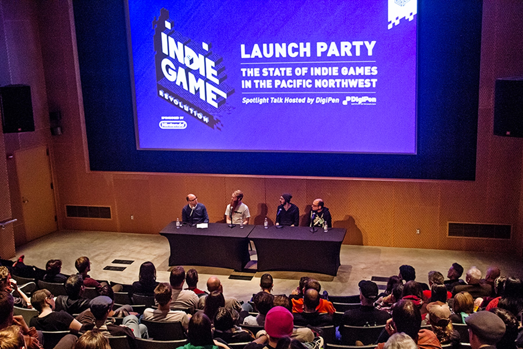 Zach Aikman speaking on a panel at Indie Game Revolution at the EMP museum in Seattle