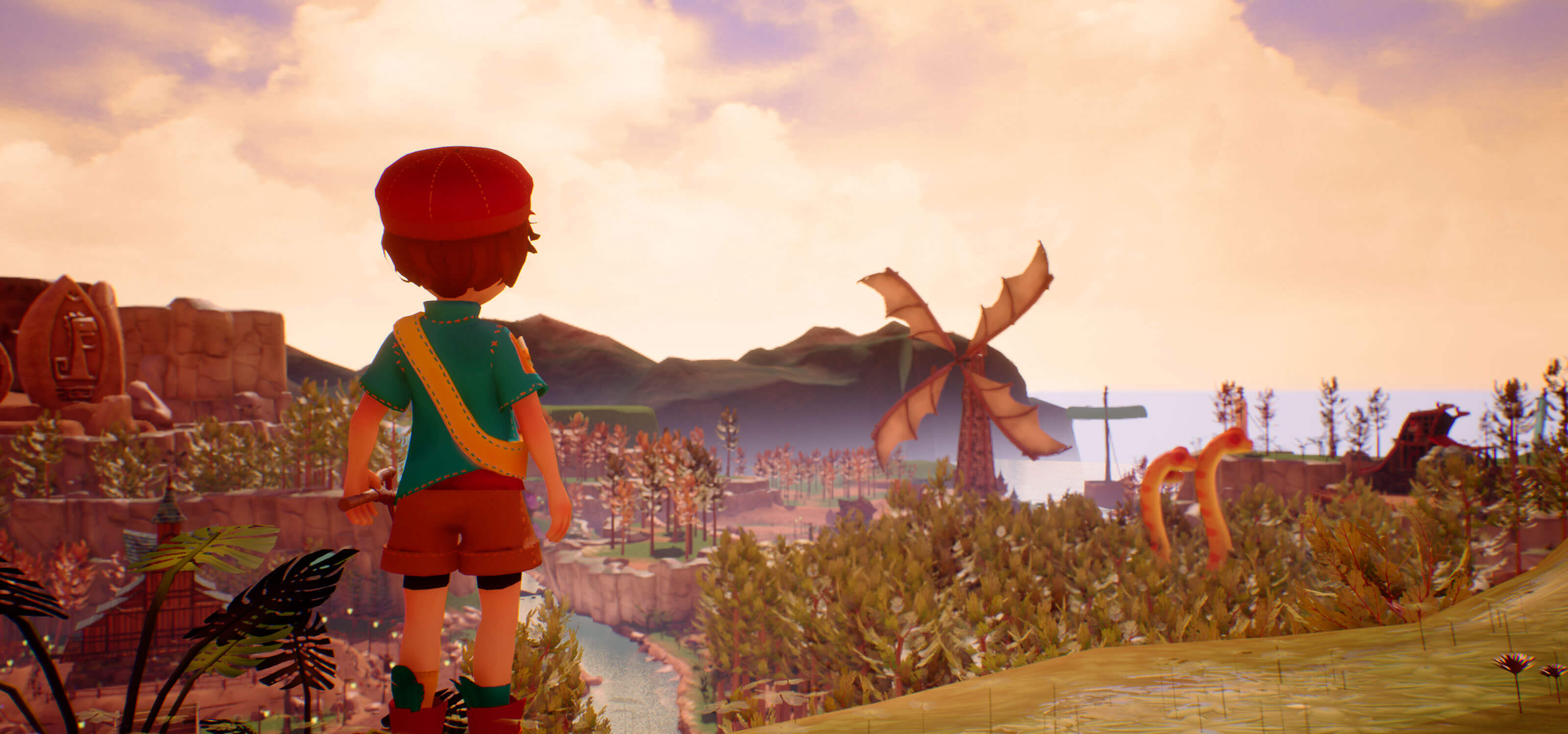 A boy looks out over a prehistoric valley landscape.