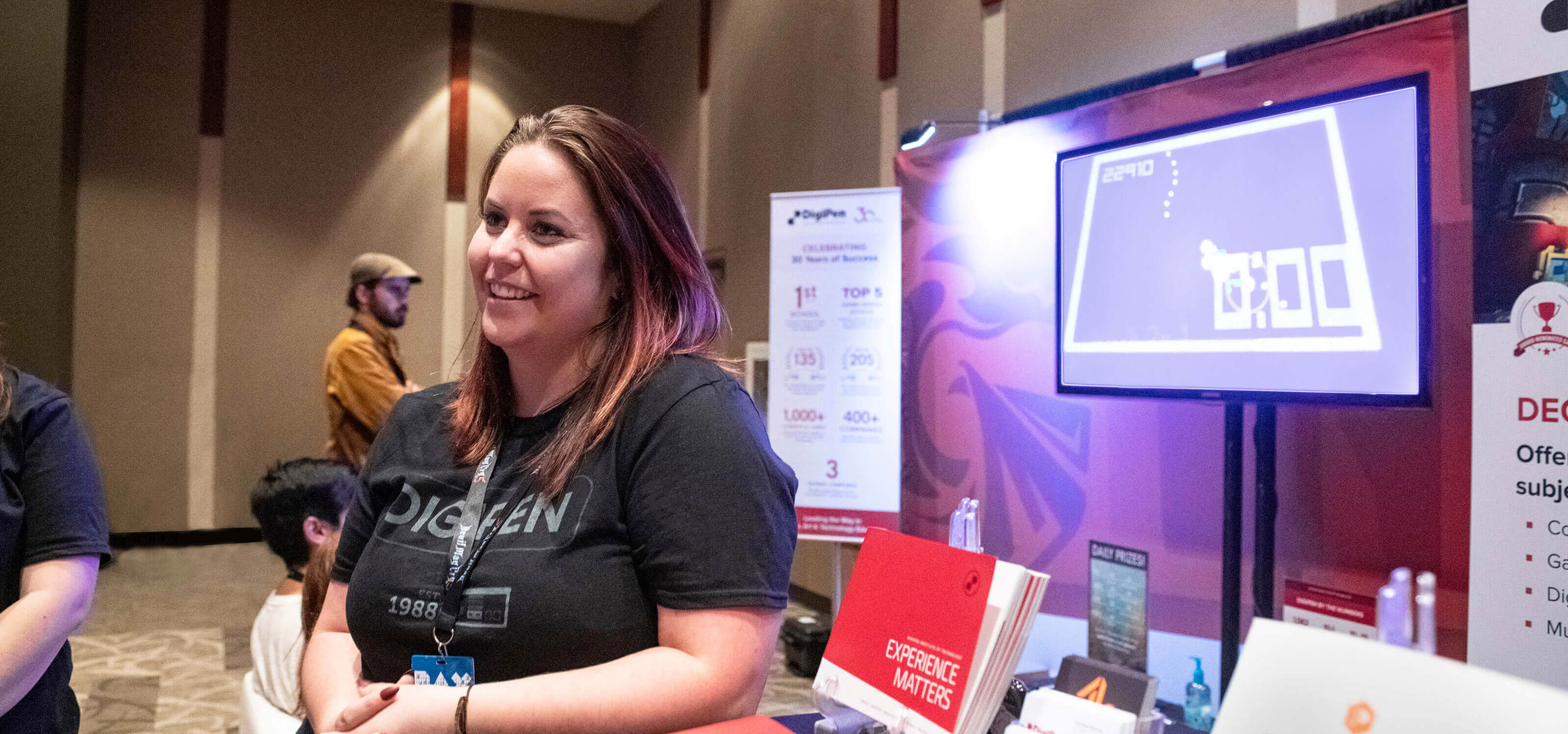 A DigiPen outreach staff member speaking to prospective students at PAX West