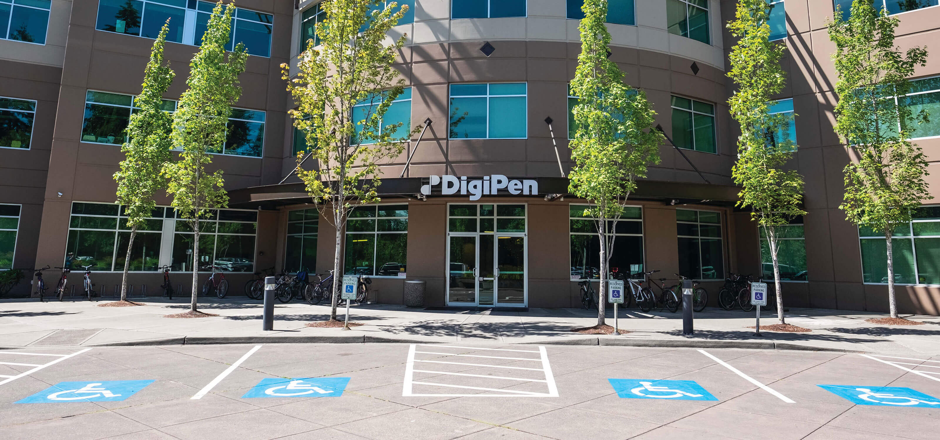 A photo of the DigiPen main entrance taken on a sunny day